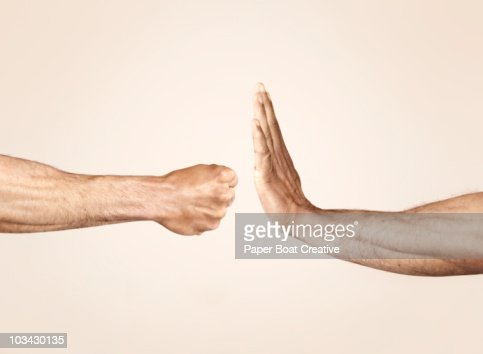Hands symbolizing defensive and offensive force : Stockfoto