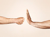 Hands symbolizing defensive and offensive force