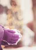 Hands (gloves) taking snow in winter