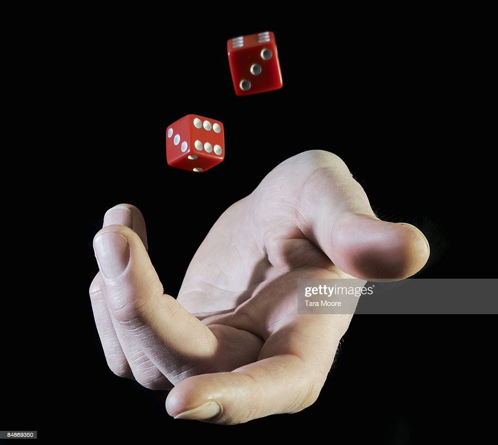 hands throwing up dice : Stock Photo