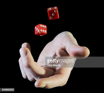 hands throwing up dice : Photo