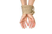 Hands tied with rope isolated on white