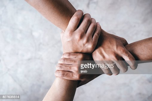 Hands together  showing teamwork. : Stock Photo