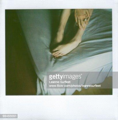 Hands touching feet : Stock Photo