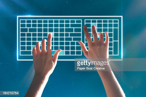 Hands typing on virtual keyboard stars background
