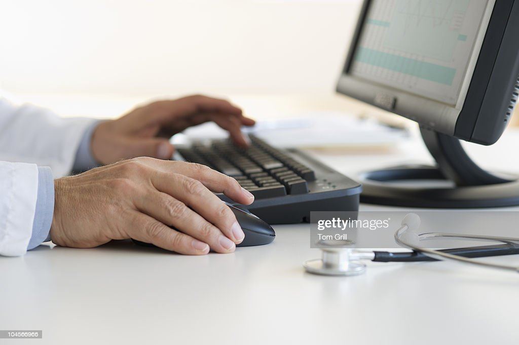Hands using computer : Stock Photo