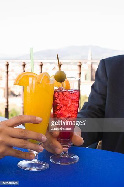 Hands with beverages