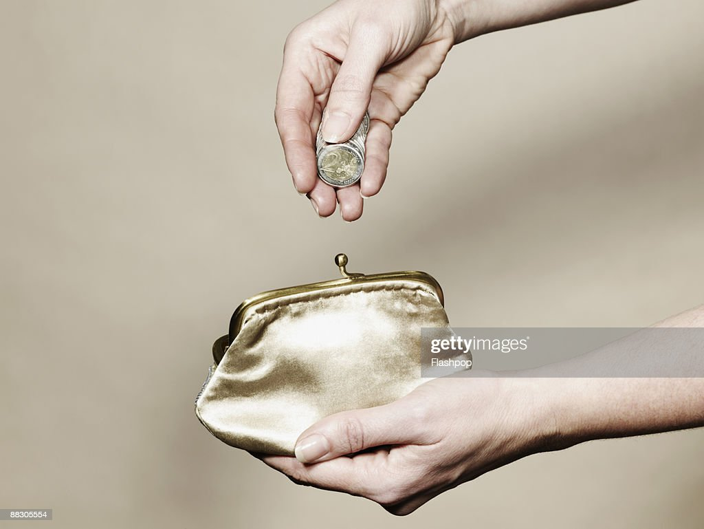 Hands with coins and purse