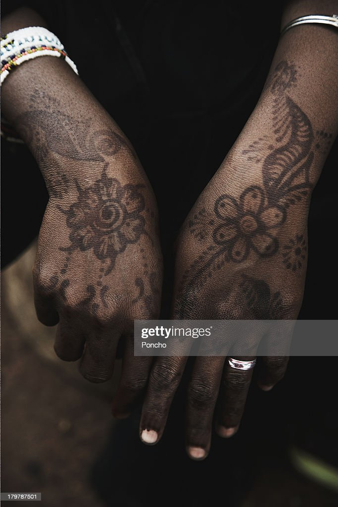 Hands with Henna of merchant woman : Stock Photo