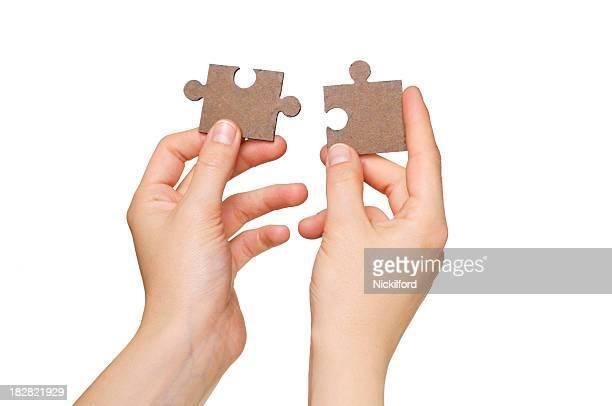 Mãos com Quebra-cabeça de peças