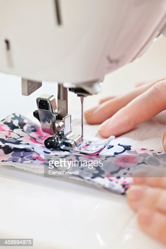 Hands with sewing machine : Stock Photo