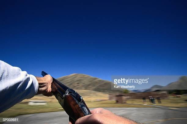 Hands with Shotgun