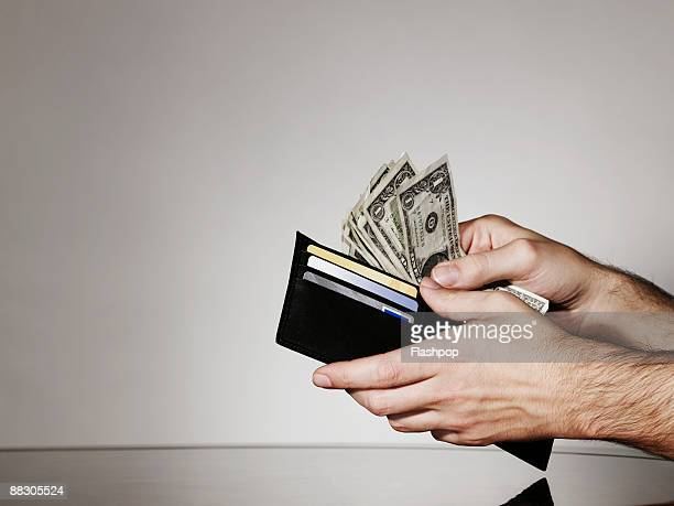 Hands with wallet and cash
