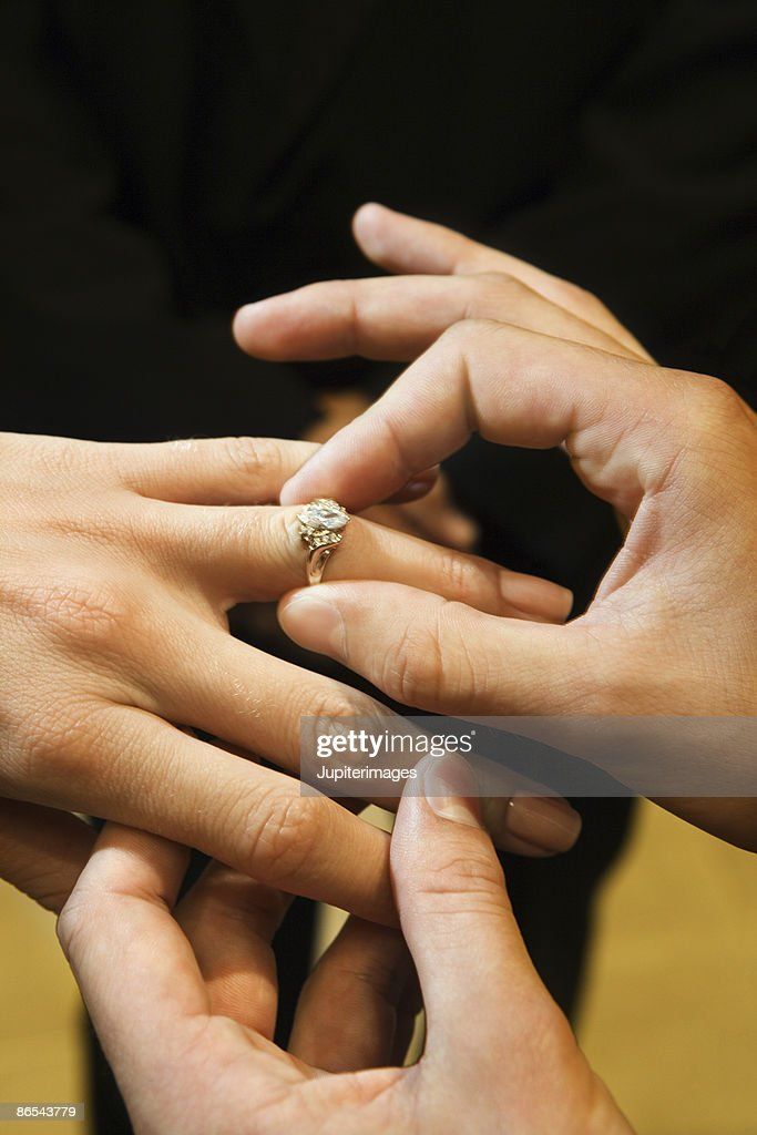 Hands With Wedding Ring Stock Photo