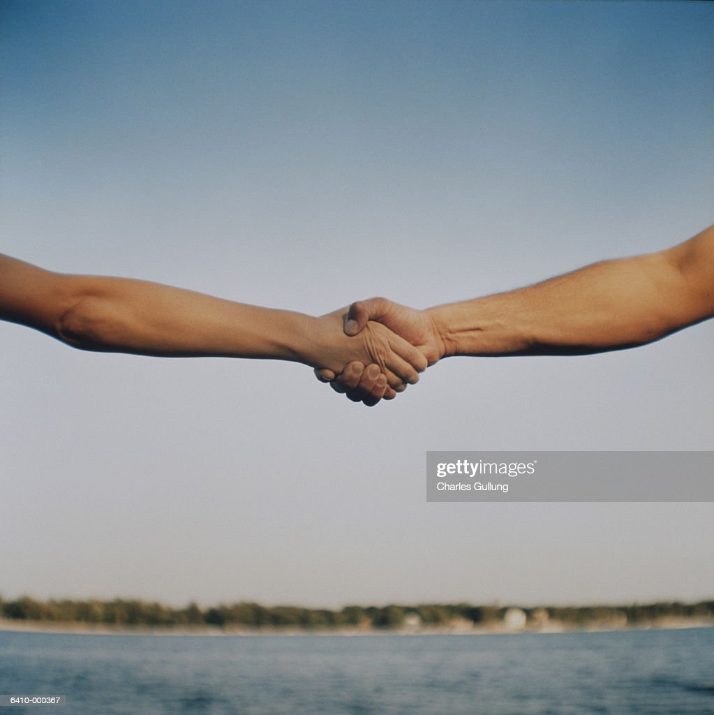 Handshake and Horizon : Bildbanksbilder