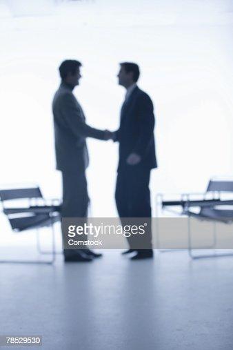 Handshake between businessmen : Stock Photo