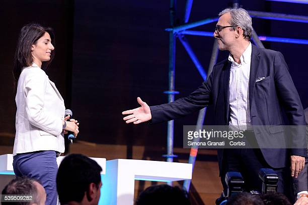 Handshake between candidate for mayor of Rome Virginia Raggi and Roberto Giachetti during a meeting of Union of Industrialists on June10 2016 in Rome...