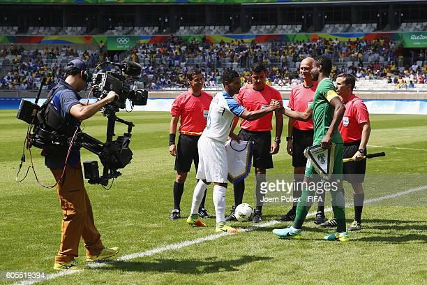 Handshake between John Mikel Obi of Nigerie and Bryan Acosta of Honduras before the Men's Olympic Football Bronze Medal match between Honduras and...