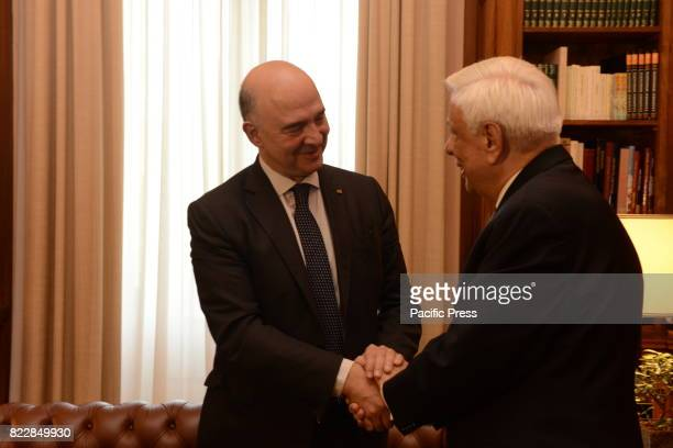 MANSION ATHENS ATTIKI GREECE Handshake between Pierre Moscovici European Commissioner for Economic and Financial Affairs Taxation and Customs and...