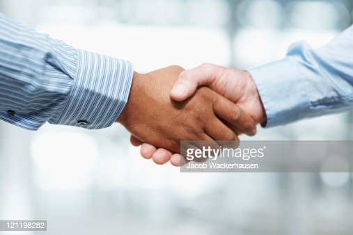 Handshake between two business executives : Stock Photo