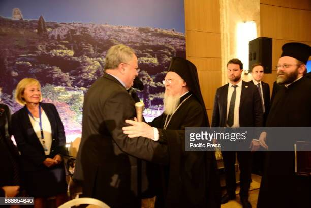HOTEL ATHENS ATTIKI GREECE Handshake of Nikos Kotzias Greek Minister of Foreign Affairs and His All Holiness Bartholomew Archbishop of Constantinople...