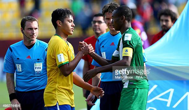 Handshake of peace between Evander of Brazil and Kelechi nwakali of Nigeria after the FIFA U17 Men's World Cup 2015 quarter final match between...