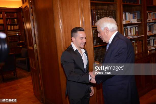 MANSION ATHENS ATTIKI GREECE Handshake of President of Hellenic Republic Prokopis Pavlopoulos with golden medalist of rings Lefteris Petroulias