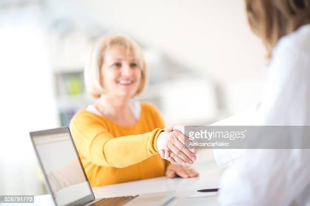 Handshake with a patient