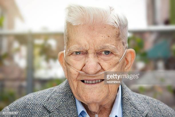 Handsome 90 Year Old Man Outdoors Wearing Oxygen