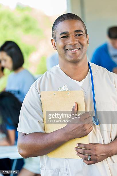 Handsome African American male nurse with clipboard