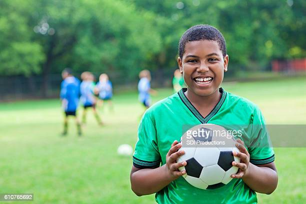 Handsome African American soccer player after winning game