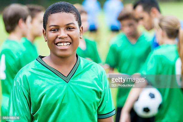 Handsome African American  teenage male soccer player