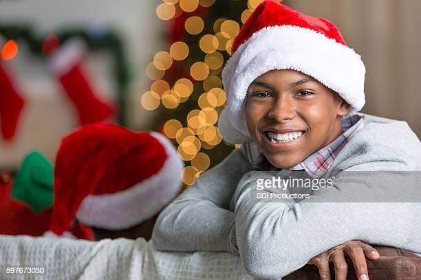Handsome African American teenager relaxes on Christmas Eve