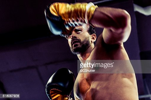 Handsome and Muscular Boxer Guarding Against His Opponent