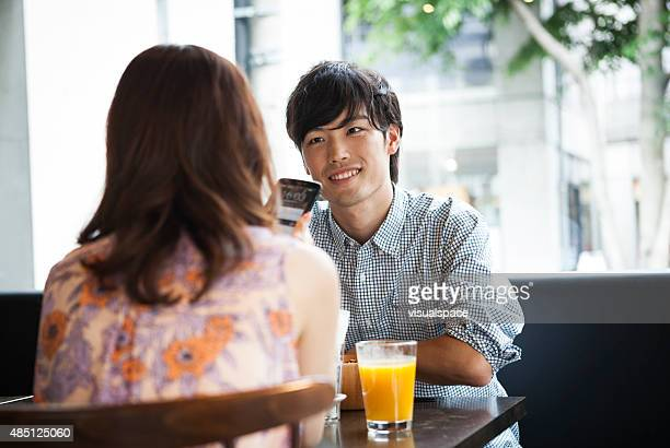 Handsome asian man with girlfriend in cafe
