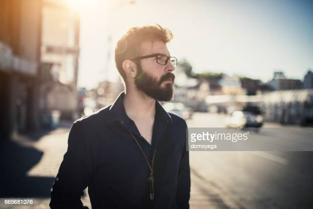 Handsome bearded businessman in the city street