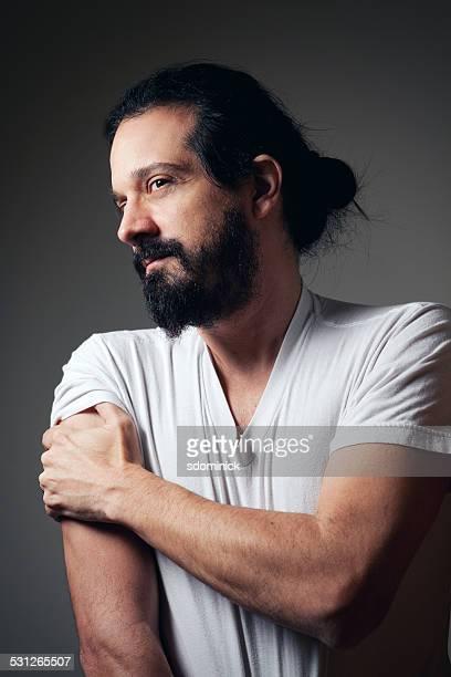 Handsome Bearded Man Wearing A Bun