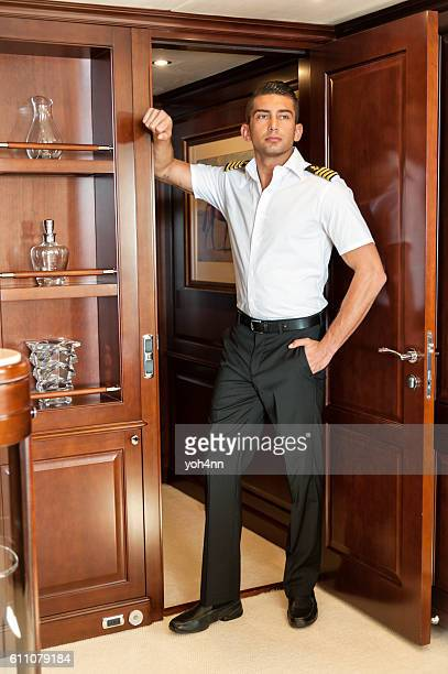 Handsome boat captain in luxury yacht