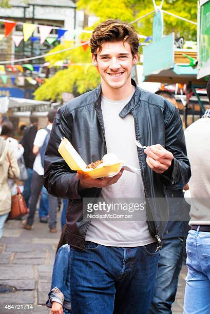 Handsome British man portrait with food at London fair