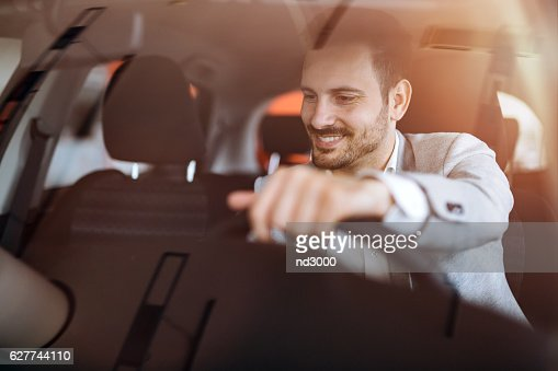 Handsome businessman driving car : Stock Photo