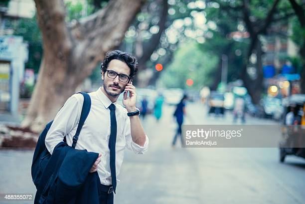 handsome businessman going back from work