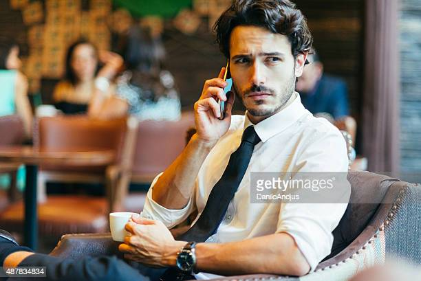 handsome businessman having a conversation on the phone