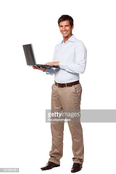 Atractivo hombre sosteniendo portátil. Aislado