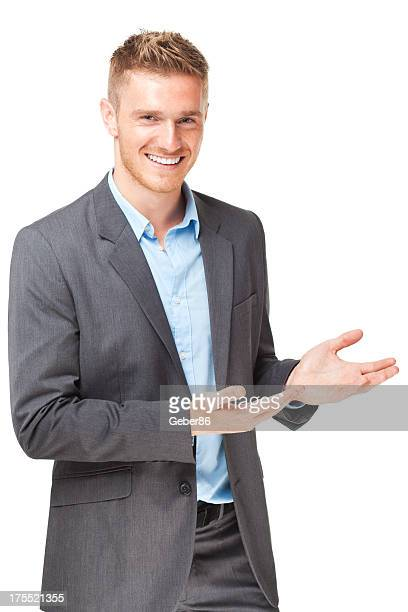 Handsome businessman presenting over white background