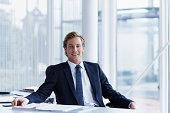 Handsome businessman sitting at desk
