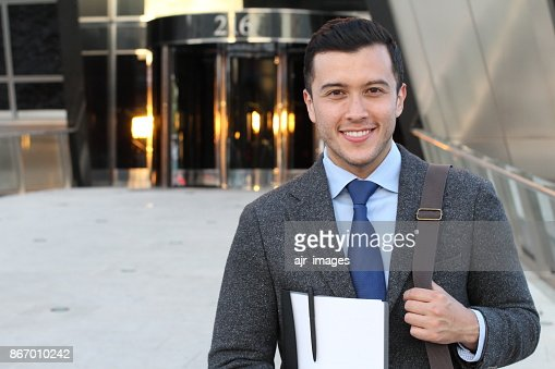 Handsome businessman smiling outside the office building : Stock Photo