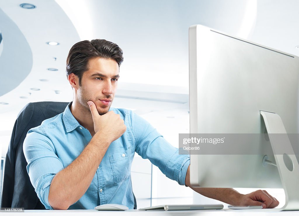 handsome businessman using computer : Stock Photo