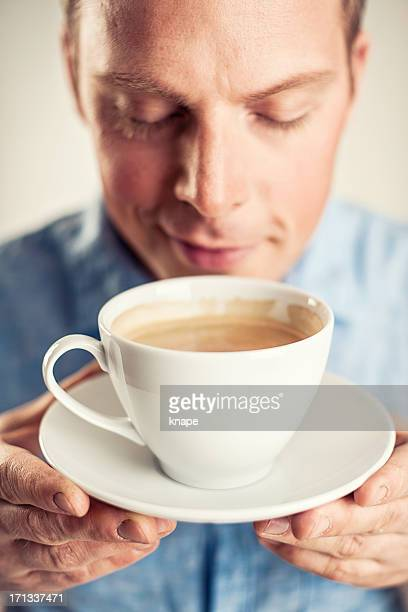 Handsome businessman with cup of coffee