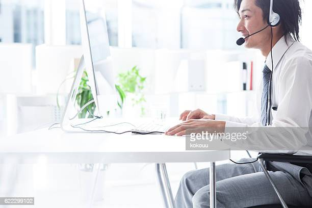 Handsome businessman working at the call center