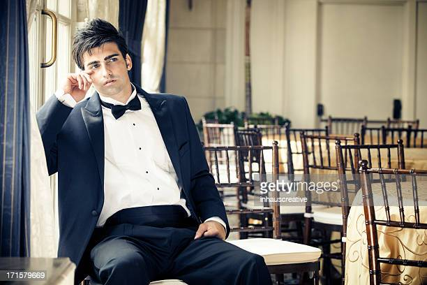Handsome caucasian male in tuxedo after the party